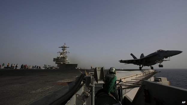 F/A-18C Hornet takes off for Iraq from flight deck of aircraft carrier USS George HW Bush in the Gulf. 10 Aug 2014