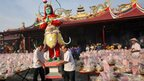 "Ethnic-Chinese Indonesians carry an effigy of the ""king of ghost"" during the ""hungry ghost"" festival in Medan, North Sumatra, Indonesia, on Sunday, 10 August, 2014"