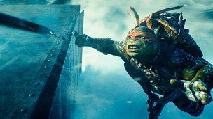 Character Michelangelo in a scene from Teenage Mutant Ninja Turtles