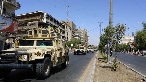 Armoured vehicles on Baghdad street - 11 August
