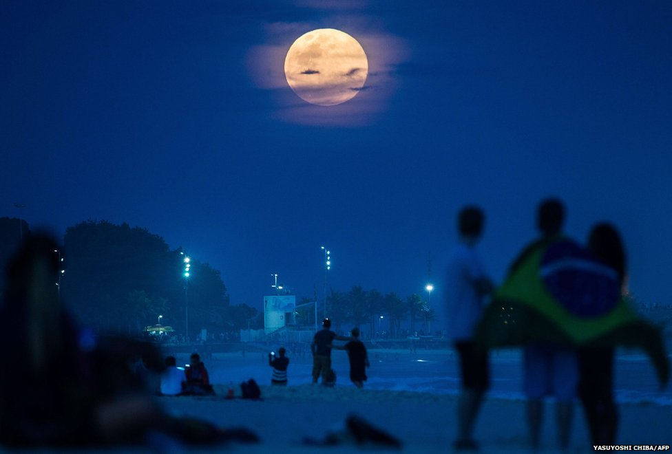 "The full moon, nicknamed ""the supermoon"", rises at Ipanema beach in Rio de Janeiro, Brazil,"