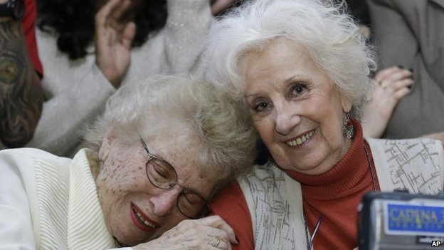Grandmothers of Plaza de Mayo, Rosa Roisinblit (left), 95, and Estela de Carlotto (right), hug during a news conference in Buenos Aires, Argentina on 5 August 2014.