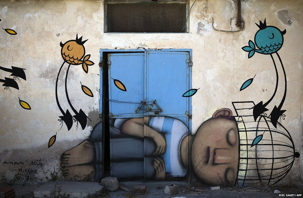A mural by French artist SETH decorates a wall in the village of Erriadh, on the Tunisian island of Djerba