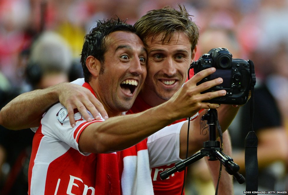 Santi Cazorla (left) and Nacho Monreal of Arsenal take a photograph of themselves during the FA Community Shield match