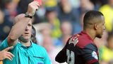 Martin Olsson is shown a red card by referee Stuart Hooper