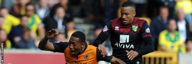 Martin Olsson tangles with Wolves' Rajiv van La Parra before being sent off