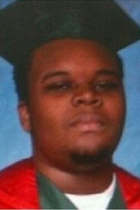 Michael Brown in a cap and gown