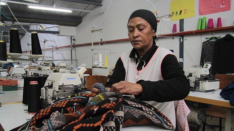 Woman working on fabric
