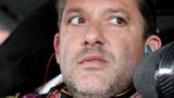 Nascar driver Tony Stewart sits at the wheel of a race car