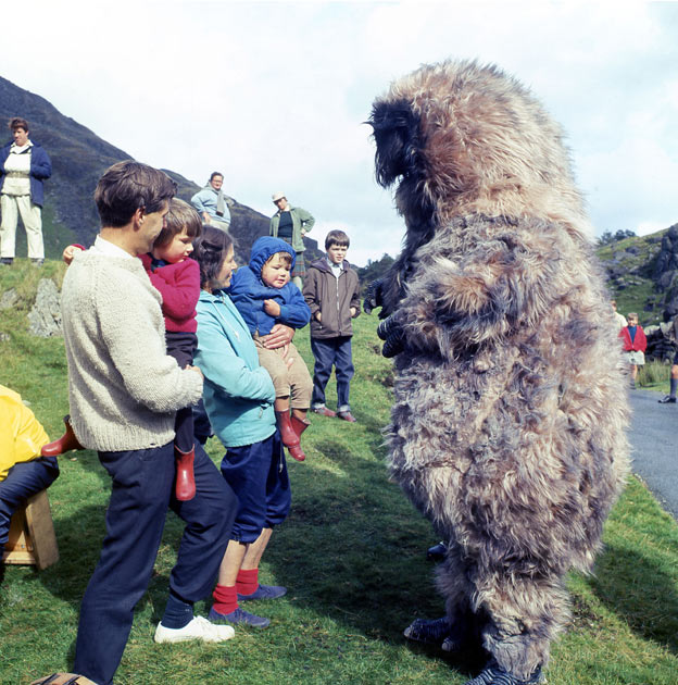 Production short of Reg Whitehead as The Yeti, meeting the locals during the filming
