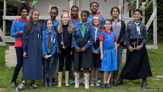 Girl Guides wearing  a mixture of old and new uniforms