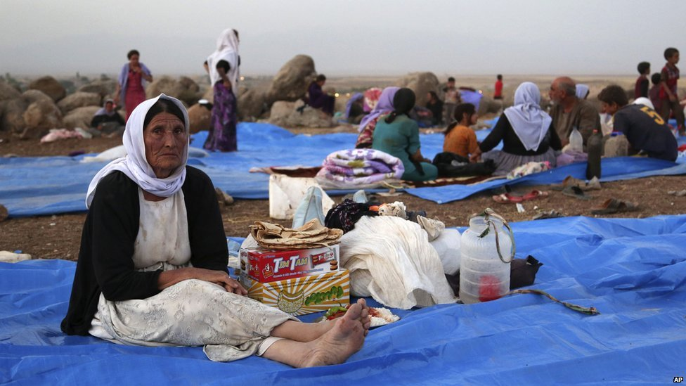 Displaced Iraqis from the Yazidi community settle at a camp at Derike, Syria, on 10 August 2014. Kurdish authorities at the border believe some 45,000 Yazidis passed the river crossing in the past week and thousands more are still stranded in the mountains.