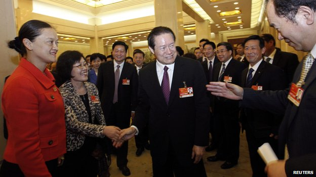 Chinese former Politburo Standing Committee Member Zhou Yongkang shakes hands with delegates as he attends a group discussion of Shaanxi Province during the National People's Congress at the Great Hall of the People in Beijing, in this file photo taken on 12 March, 2011