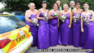 Bridesmaids with police car