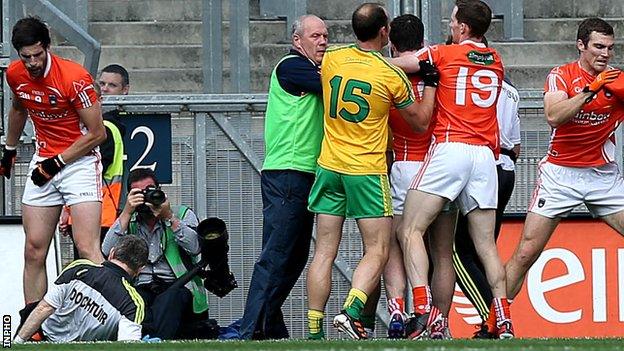 Donegal's team doctor Kevin Moran falls to the ground at Croke Park