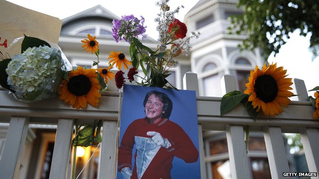 Floral tributes outside the 'Mork and Mindy house' in Boulder, Colorado