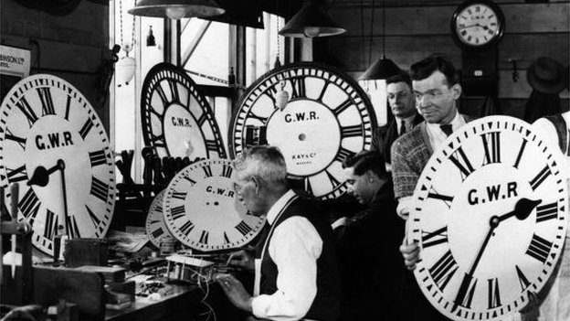 Employees at the Great Western Railway's signal works in Reading test and repair some of the company's many clocks