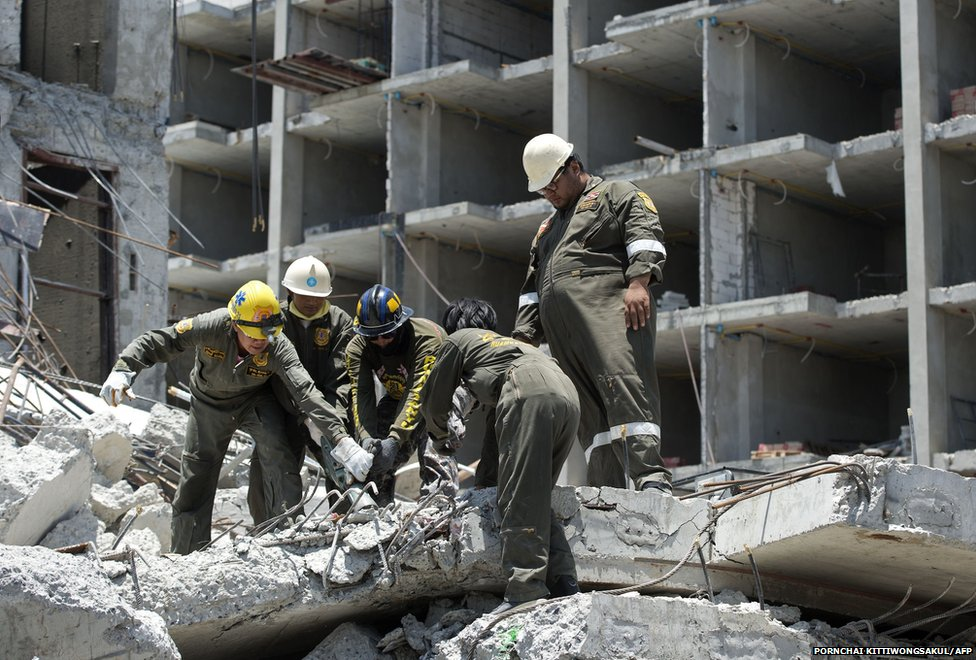 Thai rescue workers search for trapped people after a six-storey building under construction collapsed in Pathum