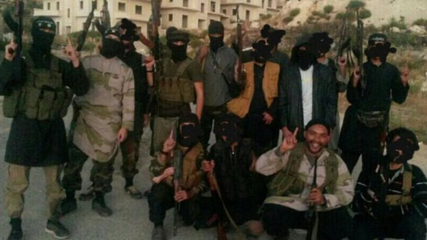 Prosecutors say this picture show Aine Davis with fighters in Syria