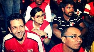 Arsenal fans in India - including Amreen Bhujwala (second left) - watch a Premier League match