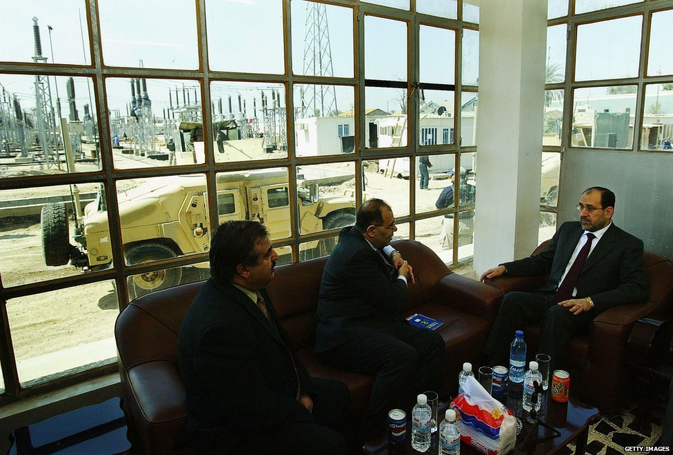 Mr Maliki at an electricity station.
