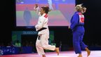 Judoka Natalie Powell celebrates after defeating England's Gemma Gibbons to secure Wales' second gold at the Commonwealth Games.