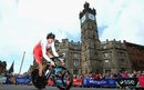 Geraint Thomas passes The Tolbooth in Glasgow's Merchant City during the men's time trial