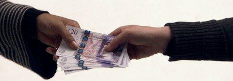 People holding money
