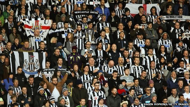 Newcastle fans stand for a minute's silence
