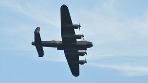 Battle of Britain Memorial Flight Lancaster Bomber flying over Guernsey