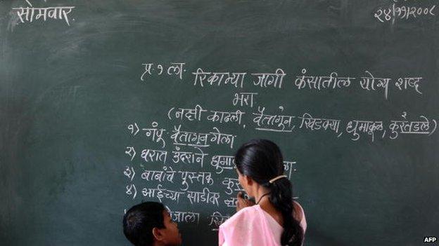 Hindi script on a blackboard in a classroom in India