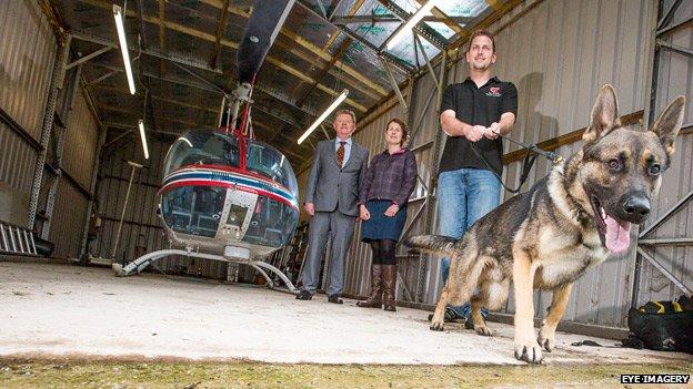 Dog trainer Matt Croxford, watched by Flintshire councillor Peter MacFarlane and Cadwyn Clwyd enterprise officer Sian Jones