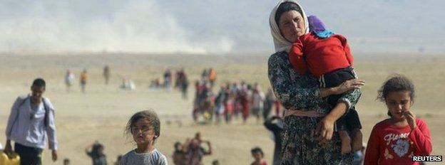 Displaced people from the minority Yazidi sect, fleeing violence from forces loyal to the Islamic State in Sinjar town