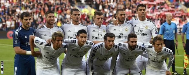 Real Madrid line up before the Super Cup game against Sevilla