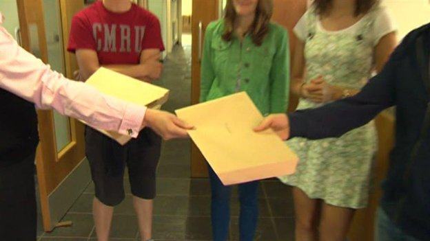 A-level students are handed their results
