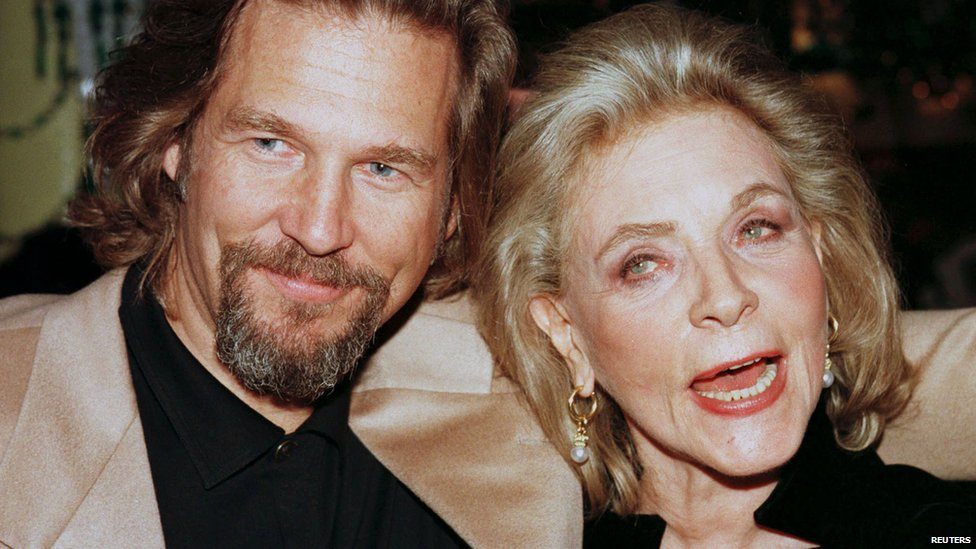 "File photo: Actor Jeff Bridges and actress Lauren Bacall, cast members of the film ""The Mirror Has Two Faces"", pose together during the film's post-premiere party in New York, 10 November 1996"