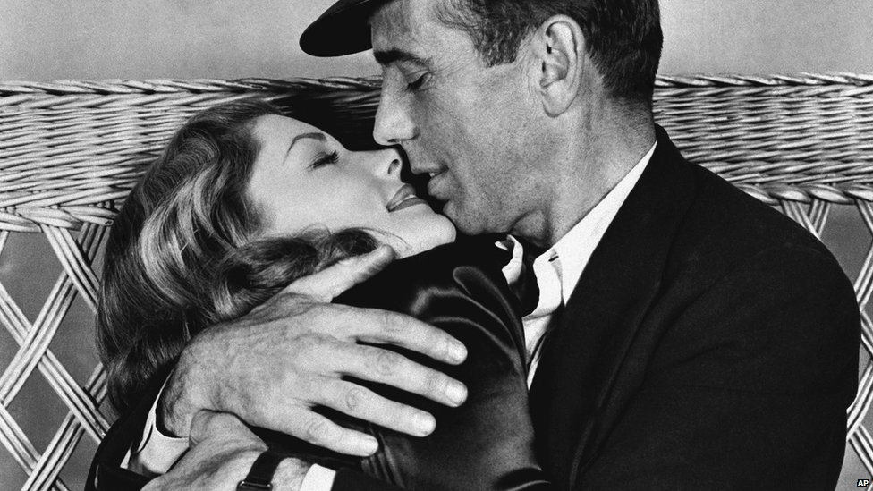 "File photo: Actor Humphrey Bogart, right, holding actress Lauren Bacall in a scene from, ""To Have and Have Not"", 1944"