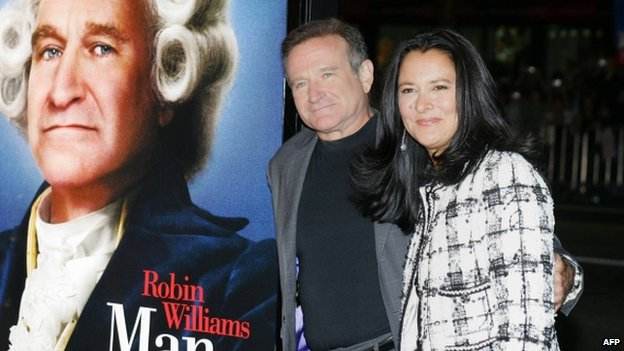 "US actor Robin Williams (L) and wife Marsha Garces Williams arriving for the premiere of Universal Pictures ""Man of the Year"" at Grauman""s Chinese Theatre in the Hollywood section of Los Angeles, California 4 October 2014"