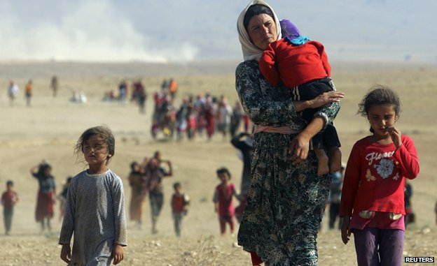 Displaced people from the minority Yazidi sect flee violence on the outskirts of Sinjar mountain
