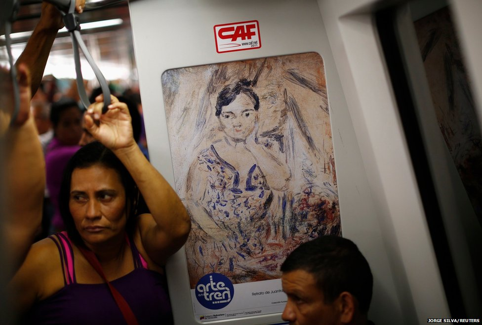 People travel on an underground train in Caracas decorated with artwork by Armando Reveron, Venezuela