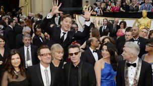Benedict Cumberbatch photobombs U2