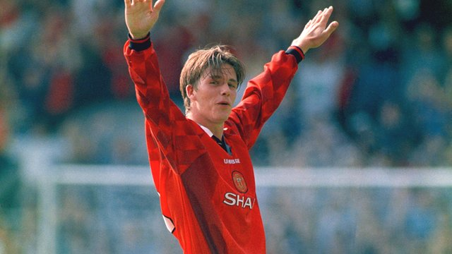 David Beckham celebrates his goal from the halfway line for Manchester United against Wimbledon in the 1996/97 Premier League season