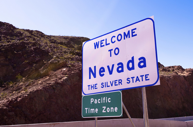 "Sign reads ""Welcome to Nevada - mountain time zone"""