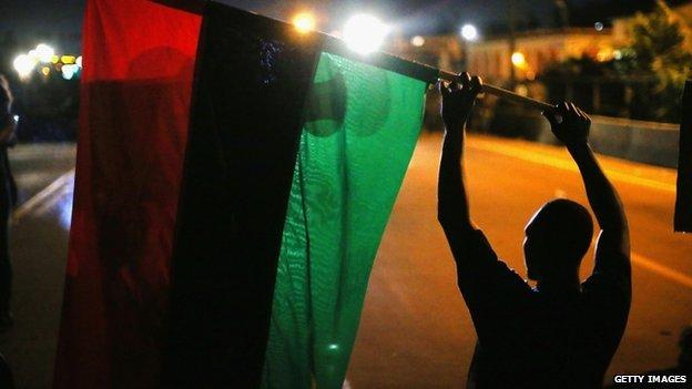 Protestor waving flag in Missouri