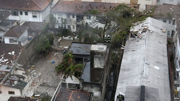 View of damaged buildings where Campos' aircraft crashed in Santos, Sao Paulo state, Brazil, 13 August 2014.