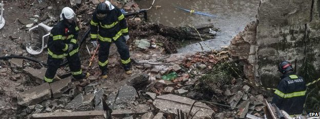 Emergency service workers at the site where the airplane crashed in Santos, Sao Paulo state, Brazil, 13 August 2014.