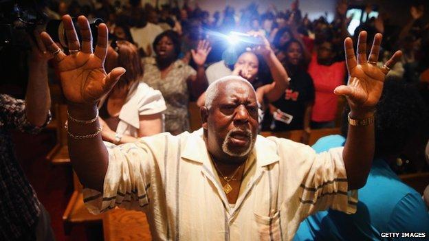 A prayer meeting in Greater St Marks Family Church, Ferguson