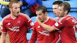 Adam Rooney, Ryan Jack and Niall McGinn congratulate Aberdeen's Peter Pawlett