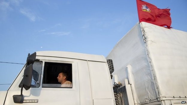 A white truck with humanitarian aid is driven from Voronezh towards Rostov-on-Don, Russia, early Thursday, Aug. 14