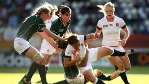 Emma Croker of England is tackled by Jenny Murphy of Ireland
